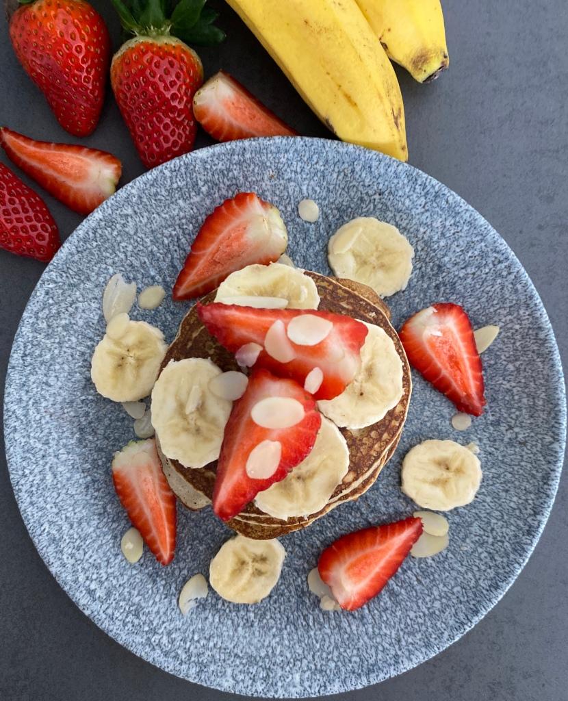 Banana Pancakes decorated with strawberries and banana