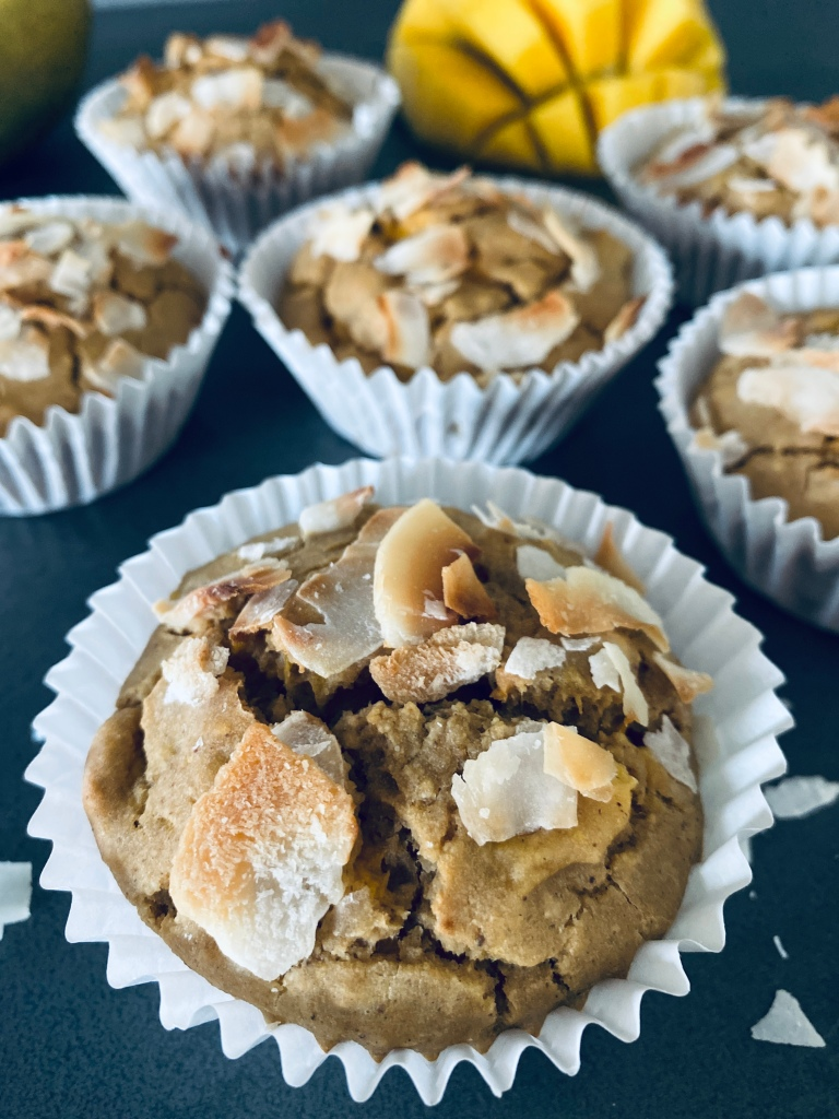 Vegan mango muffins with coconut flakes